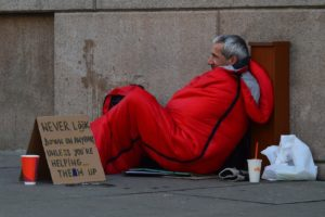 inclusive holiday celebration homeless man photo